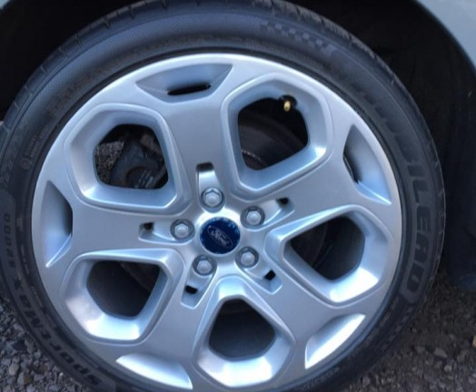 Repaired alloy wheel